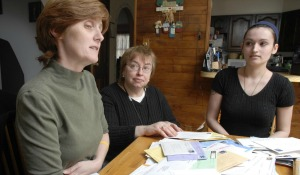East Longmeadow resident Debra Ecker, left, talks about her son, Army Sgt. Mark R. Ecker II, of East Longmeadow, with The Republican Managing Editor Cynthia G. Simison, and her daughter-in-law, Chicopee native Jennifer Gaboury Ecker, Mark's wife, right, at Debra's house on Thursday, March 8, 2007. Sgt. Ecker stepped on an explosive device outside Ramadi, Iraq,  last month and lost both feet. STAFF PHOTO BY CHRISTOPHER EVANS.